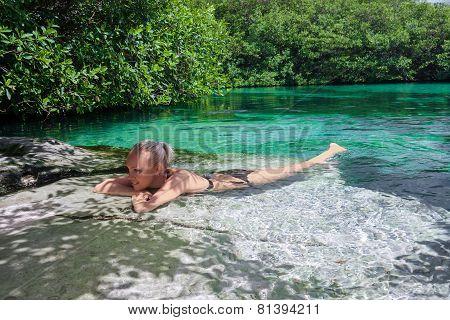 Women relax in blue lagoon