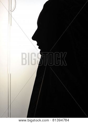 woman's face profile wearing yashmak in black and white