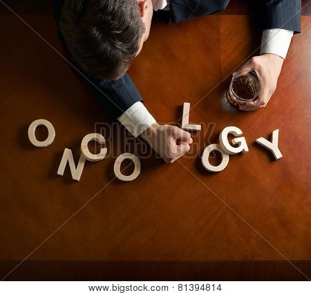 Word Oncology and devastated man composition