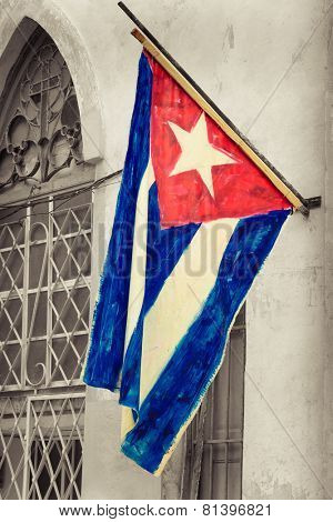 Cuban flag on a grunge decaying neighborhood in Havana