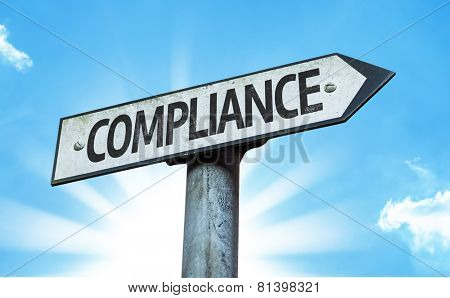 Compliance sign with a beautiful day