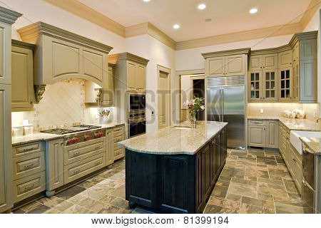luxury kitchen with new cabinets and slate floor