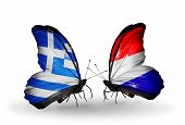 stock photo of holland flag  - Two butterflies with flags on wings as symbol of relations Greece and Holland - JPG