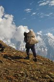 foto of sherpa  - Sherpa in picturesque Himalayas mountains in Nepal - JPG