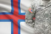 image of faroe islands  - American soldier with flag on background  - JPG
