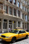 image of cabs  - New York Soho buildings yellow cab taxi of Manhattan New York City NYC USA - JPG