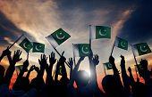 foto of pakistani flag  - Group of People Waving Flag of Pakistan in Back Lit - JPG