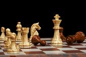 image of chessboard  - chess pieces on chessboard against black background - JPG