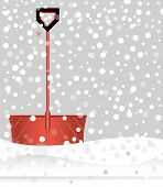 picture of snow shovel  - Red snow shovel in falling snow  - JPG