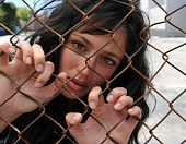 Beautiful Woman Trapped Behind A Fence.