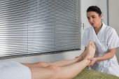 picture of pressure point  - Man is getting a massage on his body - JPG