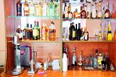 image of liquor bottle  - Assorted colorful bottles of alcoholic drinks in a bar  - JPG