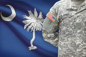 stock photo of south american flag  - American soldier with US state flag on background  - JPG