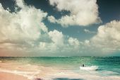 stock photo of atlantic ocean  - Small white motor boat floats moored near the coast of Atlantic ocean Dominican republic - JPG
