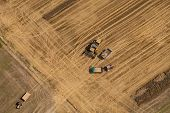 stock photo of combine  - aerial view of combine on harvest field in Poland - JPG