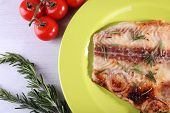 pic of pangasius  - Dish of Pangasius fillet with rosemary and cherry tomatoes in plate on color wooden table background - JPG