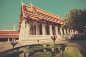 image of lilly  - A beautiful temple in Thailand with a lilly in the foreground - JPG