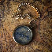 foto of compasses  - Vintage compass with chain on old map - JPG