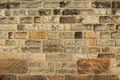 stock photo of mortar-joint  - Natural stone wall made of brown natural stones - JPG