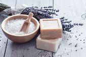 foto of lavender field  - Natural soap lavender salt on a wooden board hygiene items for bath and spa.