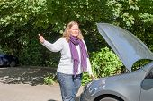picture of breakdown  - Young woman asking for help with a car breakdown - JPG