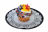 image of jimmy  - A cupcake decorated in a flower power theme and has jimmies - JPG