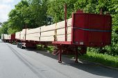 stock photo of trailer park  - Wood heavy transport park in a parking lot highway - JPG