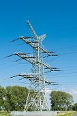 stock photo of electricity pylon  - Electricity pylon for the alternative energy supply over land - JPG