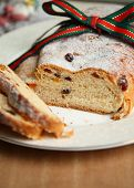 picture of cardamom  - Sliced Christmas stollen the traditional german fruit cake made of bread - JPG
