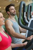 picture of cardio  - Couple doing cardio training program in fitness center - JPG