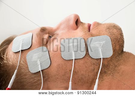 Close-up Of Man With Electrodes On Face