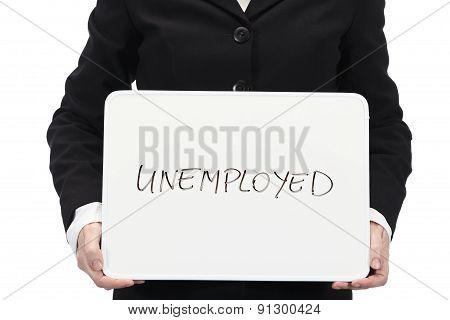 Businesswoman holding whiteboard with the word Unemployment