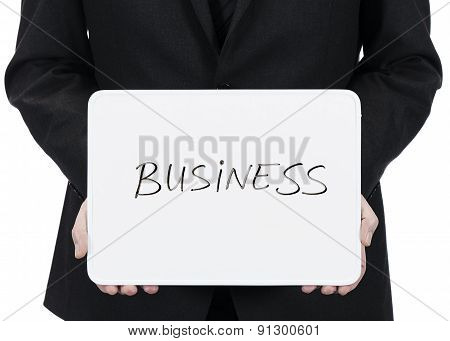 Businessman holding whiteboard with the word Business
