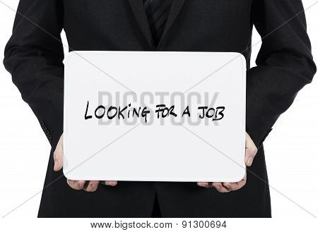 Businessman holding whiteboard with the sentence Looking for a job