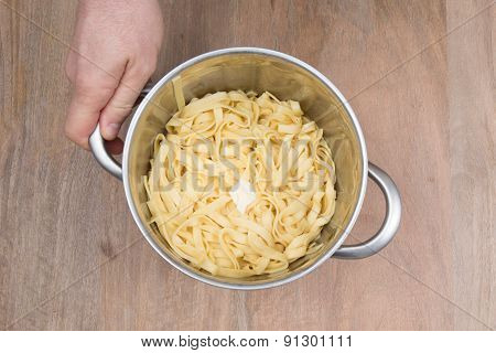 A Food theme: pasta  in a boiling water.