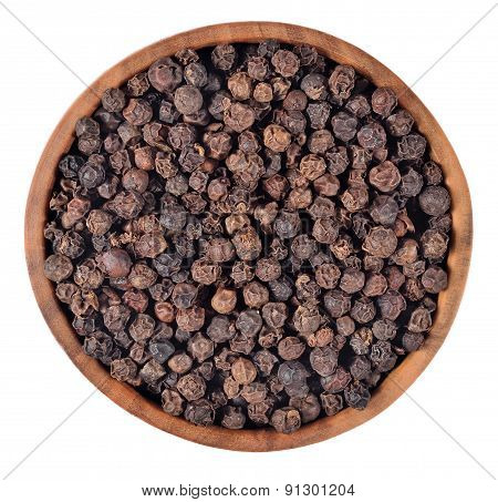 Black Pepper In A Wooden Bowl On A White