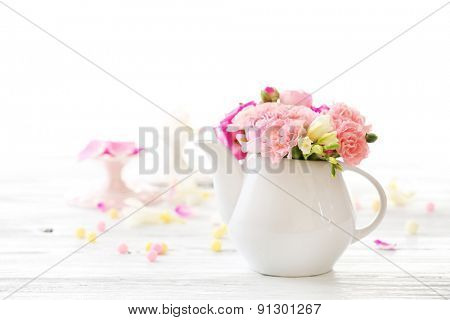 Beautiful spring flowers in teapot