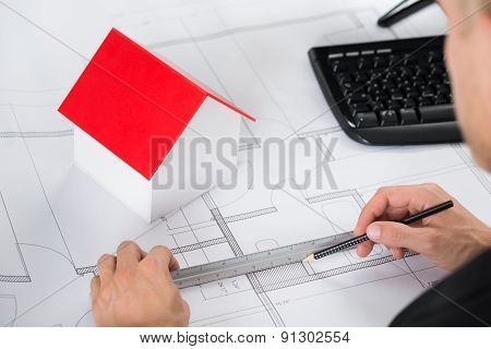 Close-up Of Architect Making Blueprint
