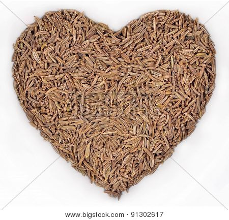 Cumin Seeds In The Form Of Heart On A White