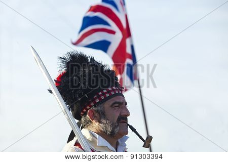 Portrait Of Scottish Officer With Flag