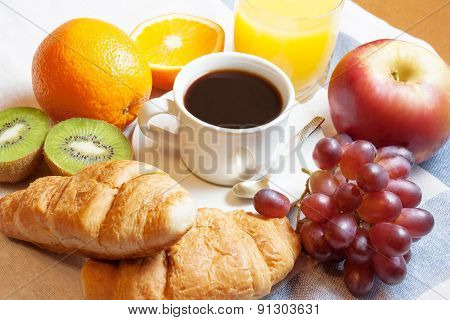 Breakfast With Coffee, Orange Juice, Croissants  And Fruits