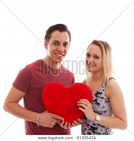 Young Couple In Love Holding Heart