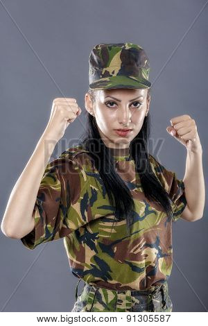 Women In Military Clothes Boxing To The Camera