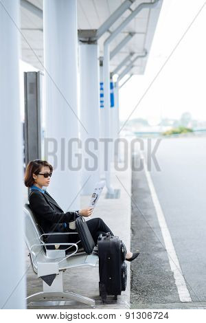 Business lady at bus station