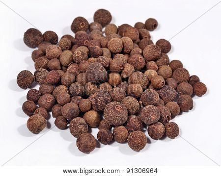 Heap Of Allspice On A White
