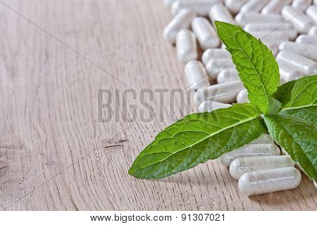 Capsules And A Sprig Of Mint