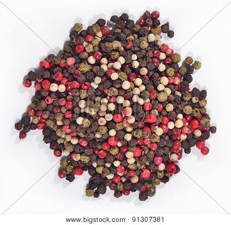 Heap Of Colored Pepper On A White