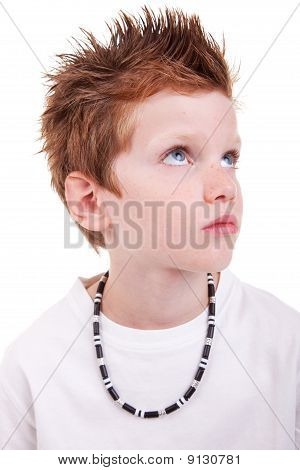 Cute Boy With A Serious Look, Looking Up, Isolated On White, Studio Shot