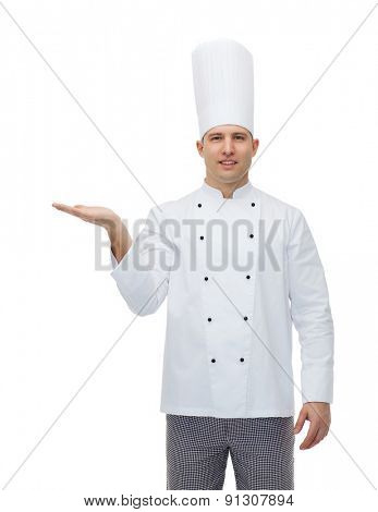 cooking, profession, advertisement and people concept - happy male chef cook showing something on empty palm