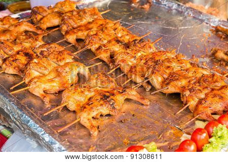 cooking, asian kitchen, sale and food concept - chicken grill at street market